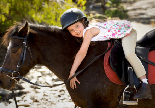 girl riding horse science page